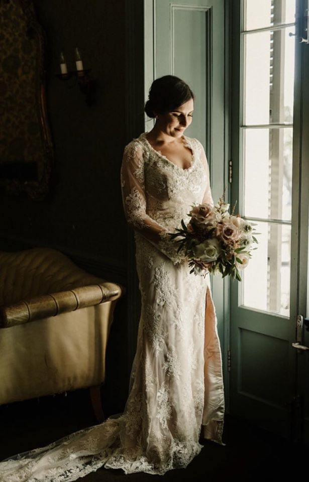 Jane Doe looking beautiful in her wedding dress at 'Name of Venue'